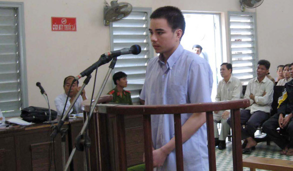 Ho Duy Hai, who was sentenced to death for the double murder of two women in Long An Province, Vietnam in 2008, stands trial at a court in this file photo.