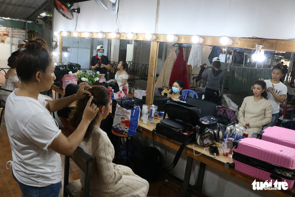 Brides-to-be have their makeup done for their photo shoots at L'amour studio in District 2, Ho Chi Minh City, Vietnam, May 13, 2020. Photo: Ngoc Phuong / Tuoi Tre