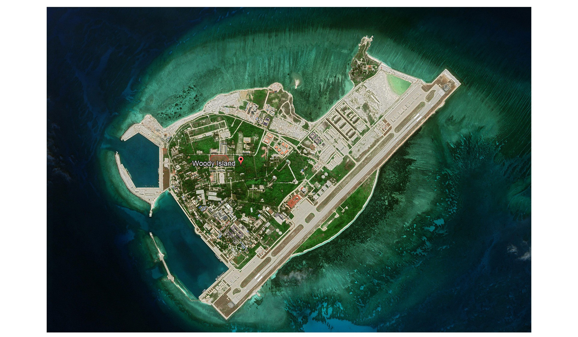 China's illegal land reclamation on the Phu Lam (Woody) Island in Vietnam's Hoang Sa (Paracel) archipelago is evident in this satellite image taken in March 2019. Photo: Google Earth