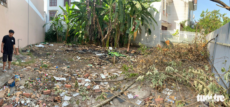 An unused land plot in Binh Chanh District, Ho Chi Minh City, Vietnam is filled with garbage, construction waste and wild plants before it was turned into a vegetable garden by Vietnamese couple Nguyen Ba Trinh and Pham Thi Anh Huyen (unseen) in this supplied photo.