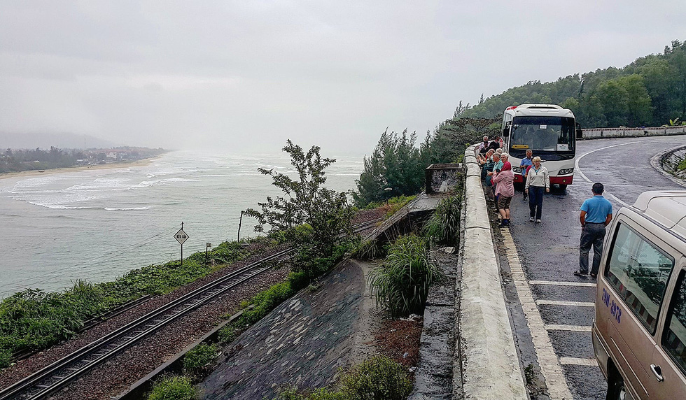 Foreign tourists stop by the Hai Van Pass where a railway runs along the coast in Thua Thien-Hue Province, Vietnam in this undated photo. Photo: Gia Tien / Tuoi Tre