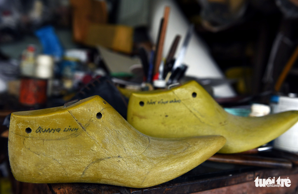 Molds used to made shoes for Vietnamese singers Quang Linh (front) and Dam Vinh Hung (back), two of Ngoc's celebrity customers. Photo: Duyen Phan / Tuoi Tre