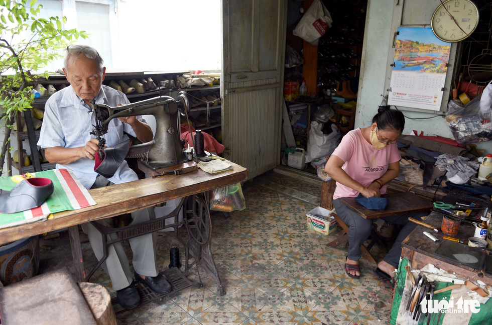 Ngoc is seen making shoes on the fourth floor of his house in Ho Chi Minh City, Vietnam. Photo: Duyen Phan/ Tuoi Tre