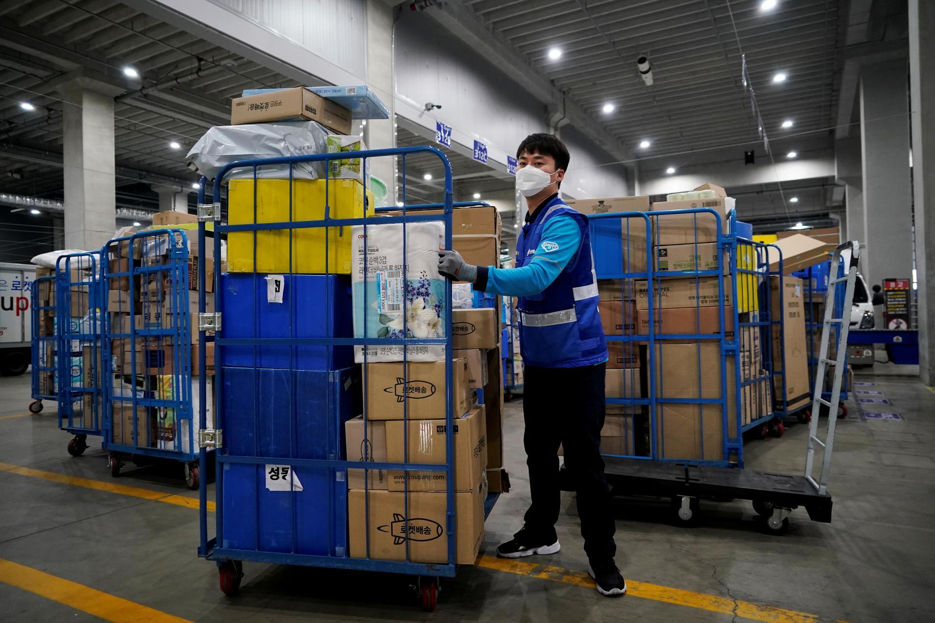 Coronavirus outbreak at South Korea e-commerce warehouse drives spike in new cases