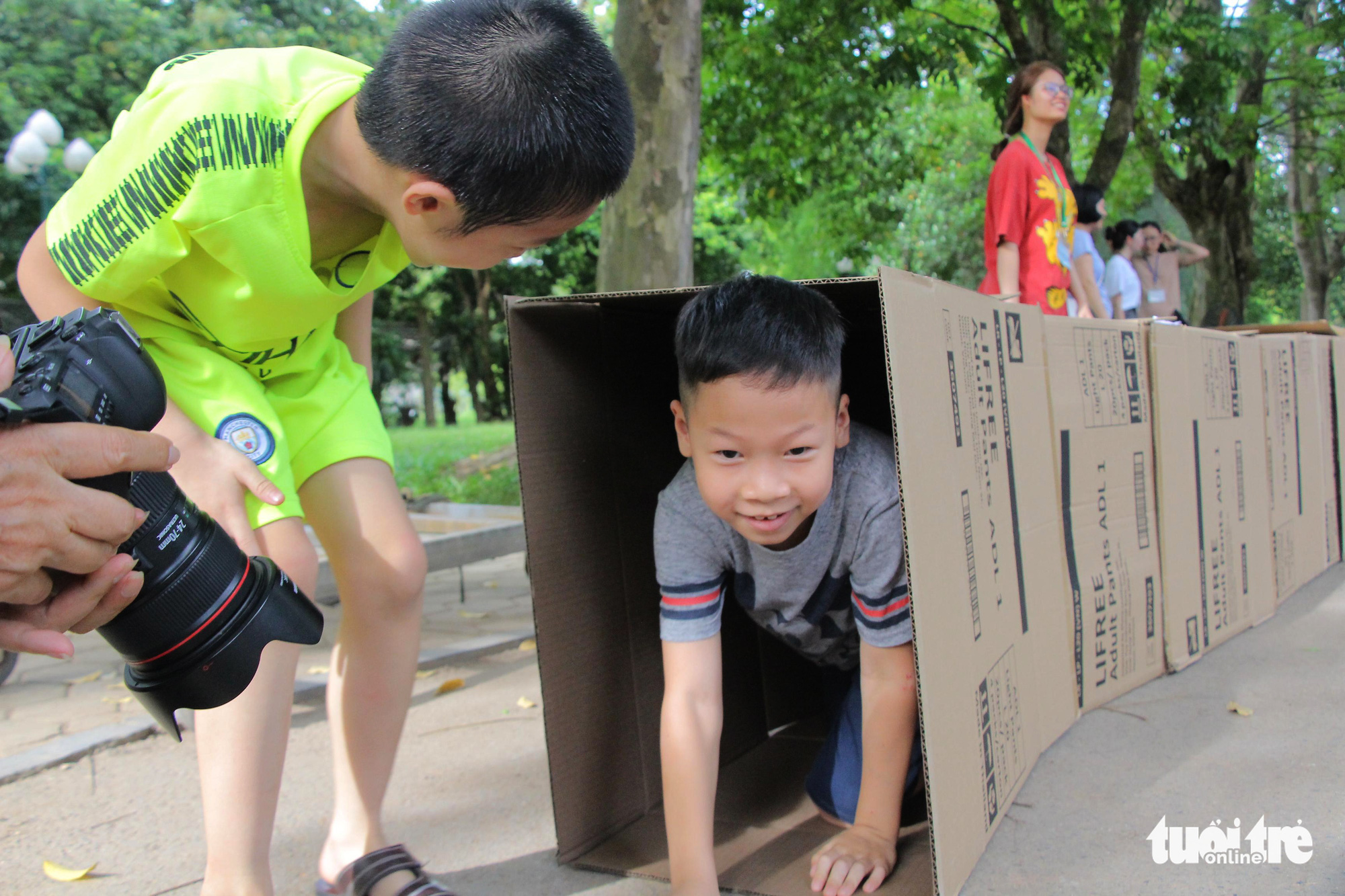 A boy plays with an obstacle course made of carton boxes at the 'Kingdom of Recycled Materials' event in Hanoi, Vietnam, May 31, 2020. Photo: Ha Thanh / Tuoi Tre