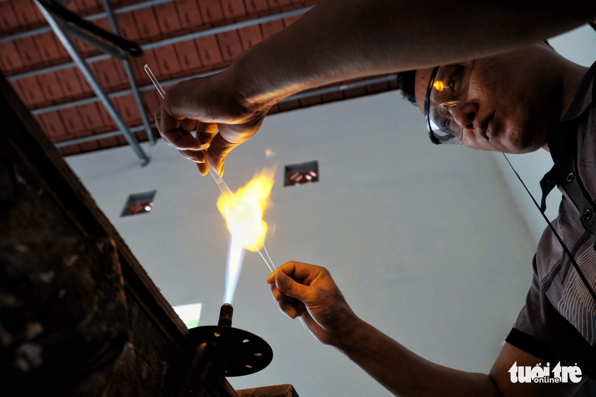 Hanoi's skilled glass-blowers keeping the flame alive
