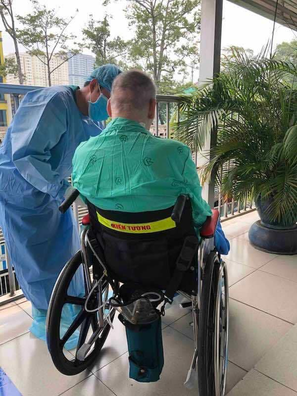 British pilot, already cleared of coronavirus, sunbathes in wheelchair at Vietnam hospital