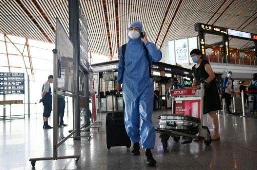 Beijing cancels flights, shuts schools over new virus outbreak