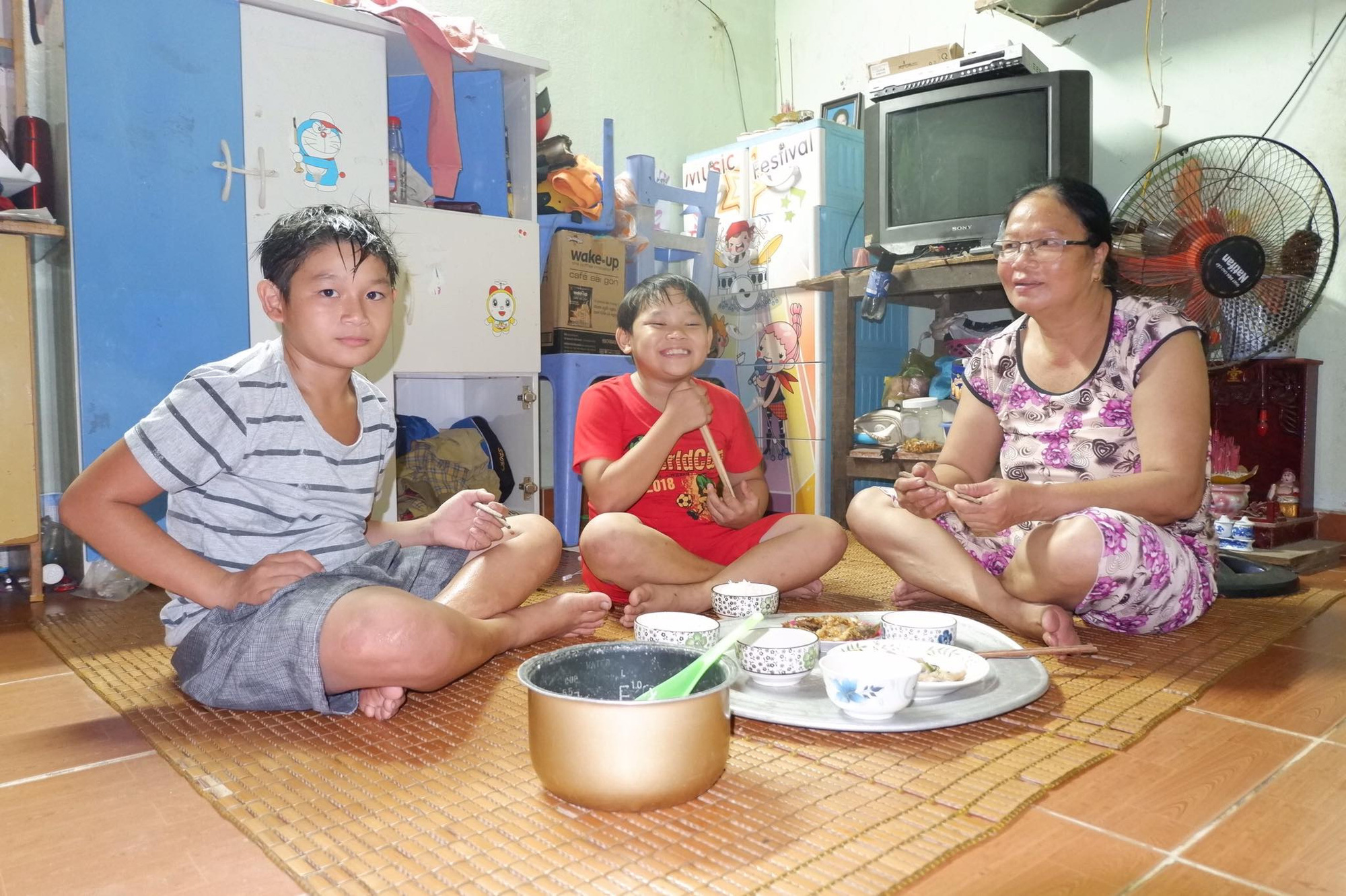 Vietnamese woman gives unconditional love to adopted sons