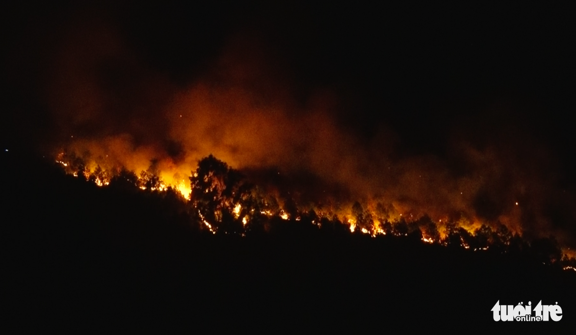 Firefighters work past midnight battling forest fires in north-central Vietnam