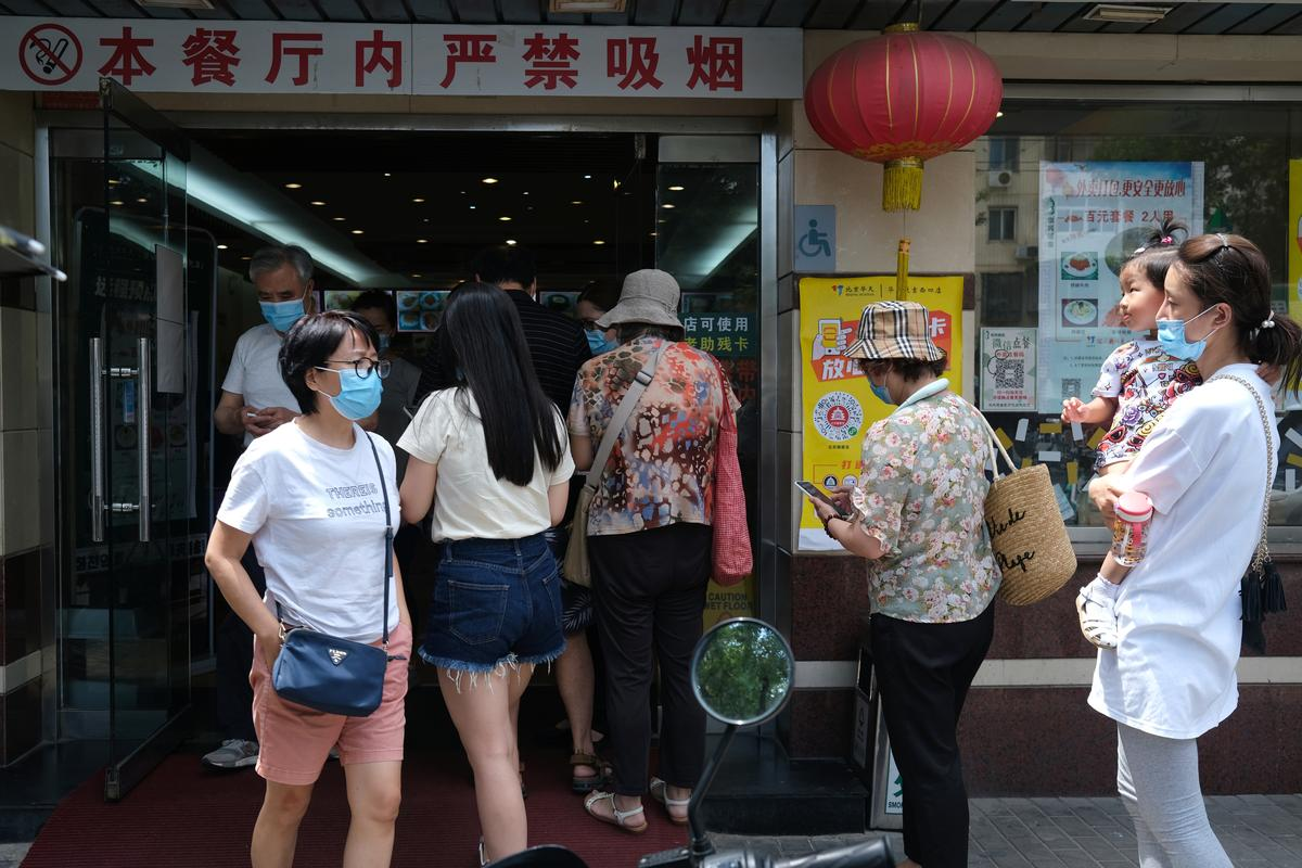 Six months after 'viral pneumonia', Wuhan returning to normal, with masks