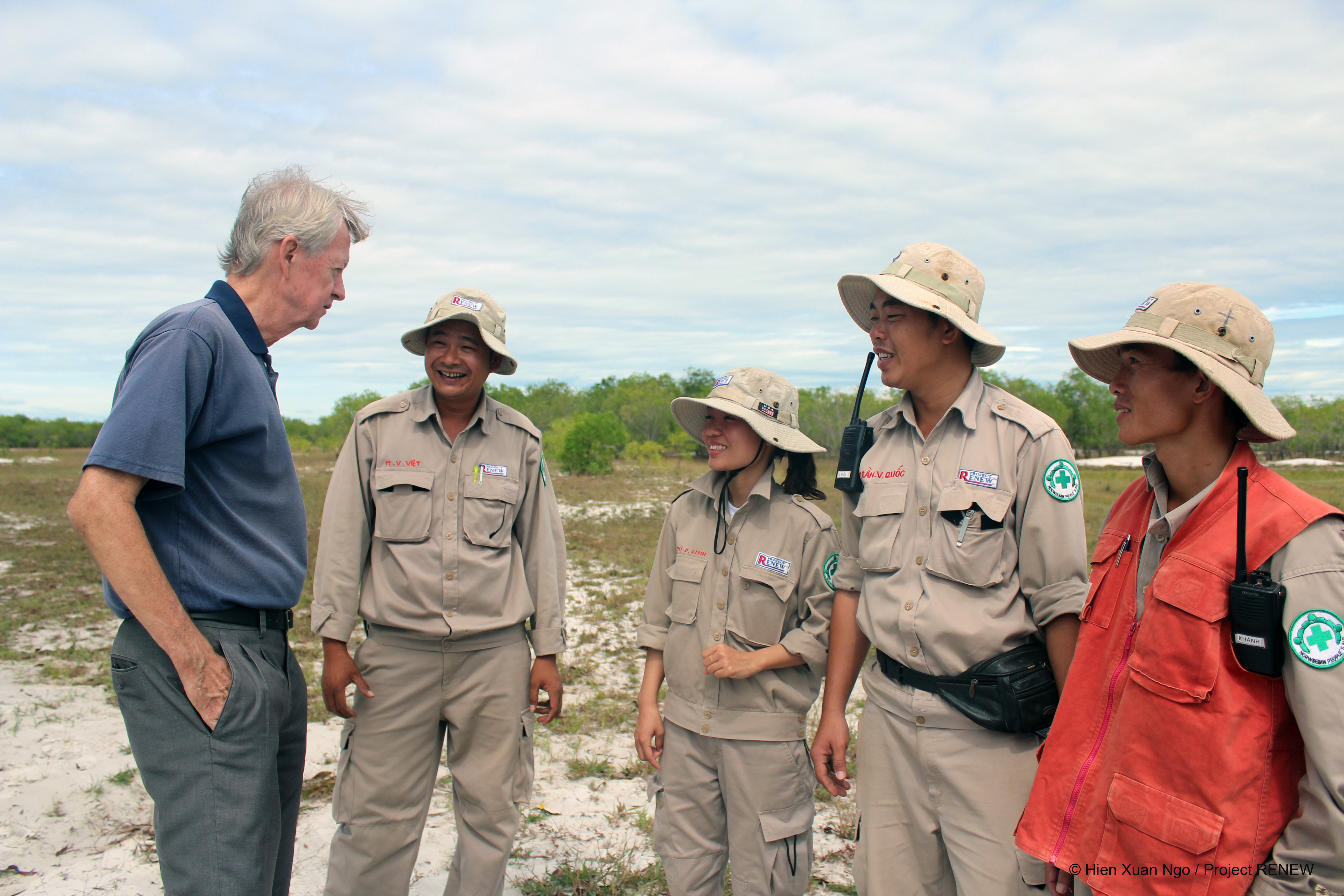 The author (left) is seen with members of Project RENEW to find and clear explosive ordnance in Quang Tri Province, Vietnam in this undated supplied photo.