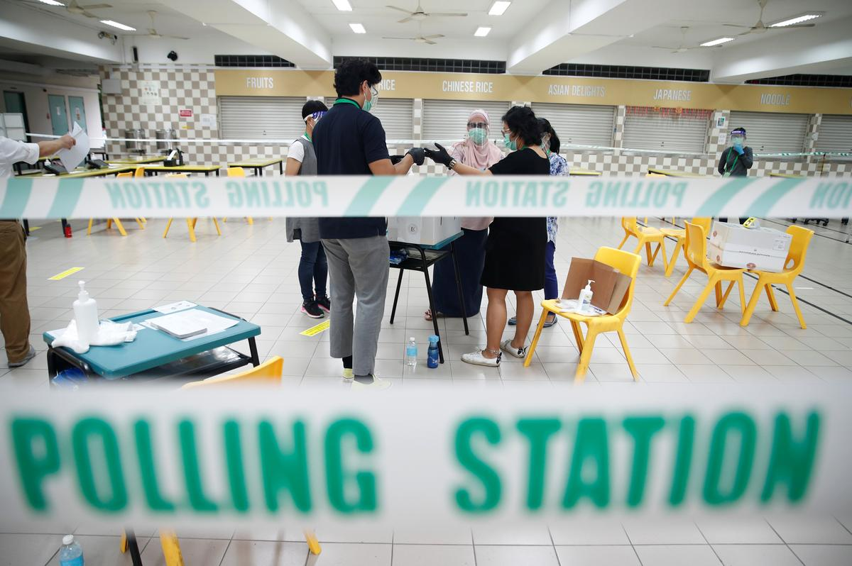 Personnel prepare ballot boxes at a polling station during Singapore's general election in Singapore July 10, 2020. Photo: Reuters
