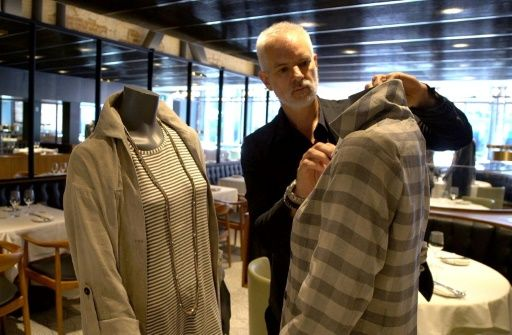 Canadian designer Philippe Dubuc dresses mannequins to be used to provide social distancing at a restaurant in Montreal's Old Town on July 10, 2020, amid the pandemic. Photo: AFP