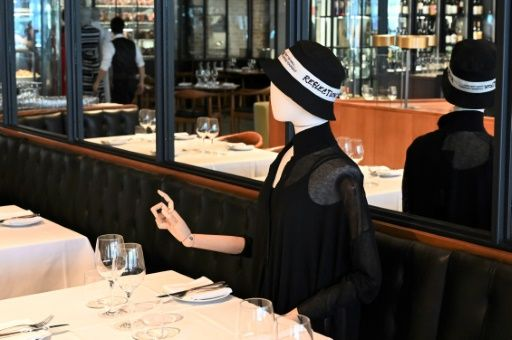A mannequin in Montreal's chic Le Monarque restaurant appears to be beckoning a waiter. Photo: AFP