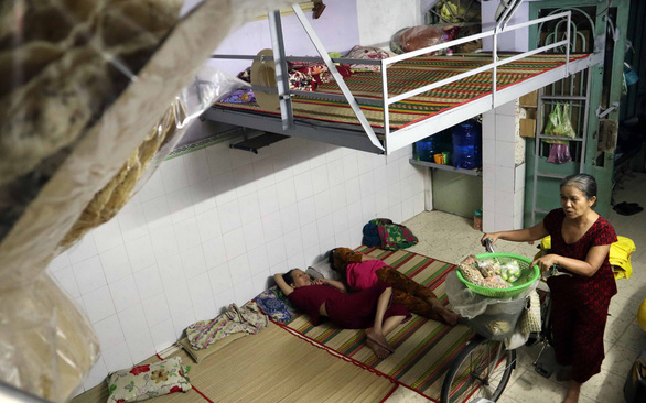 Migrant workers pay daily rent for cheap Vietnamese version of 'capsule hotel'