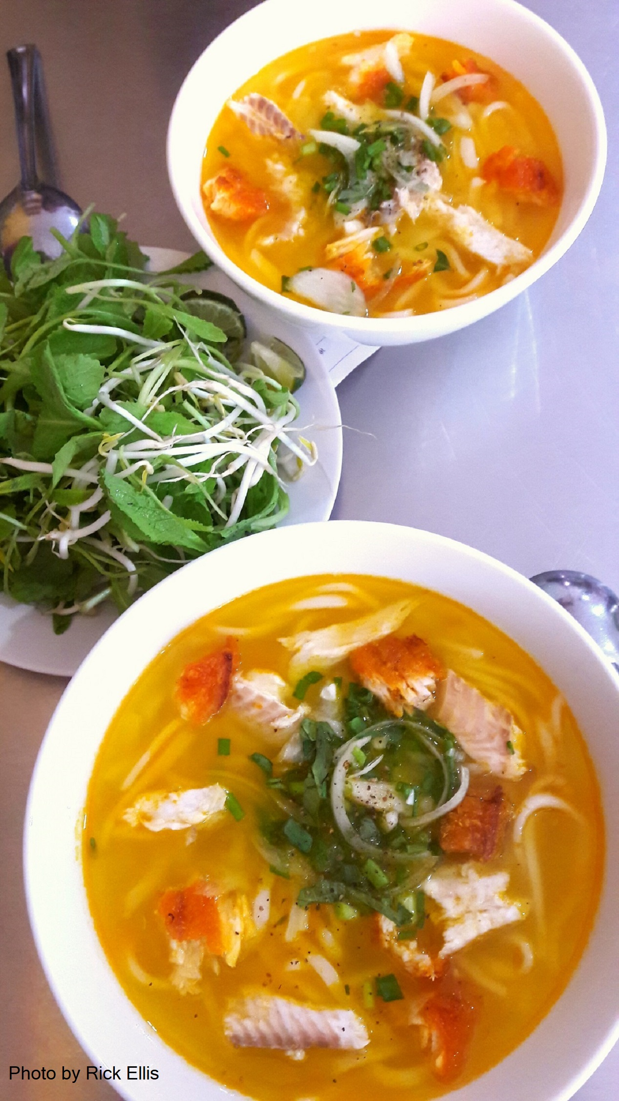Two bowls of 'bánh canh cá lóc' (fish noodle soup) served at Chú La in Da Lat City, Lam Dong Province, Vietnam. Photo: Rick Ellis