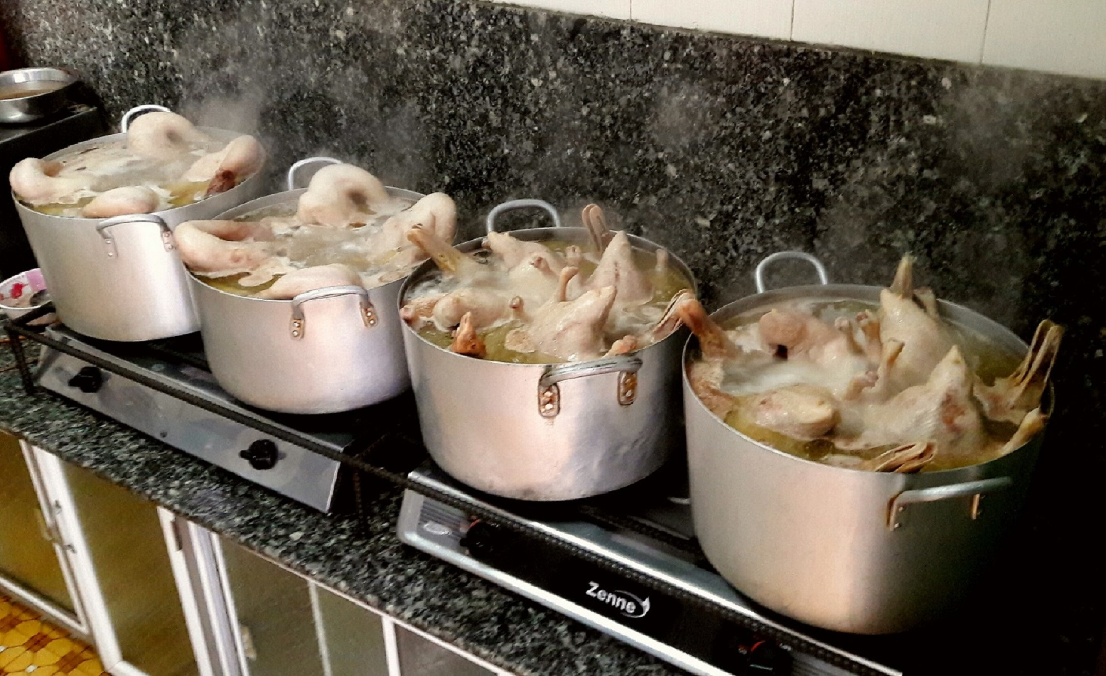 Ducks are cooked on stoves at a duck porridge shop in Da Lat City, Lam Dong Province, Vietnam. Photo: Rick Ellis