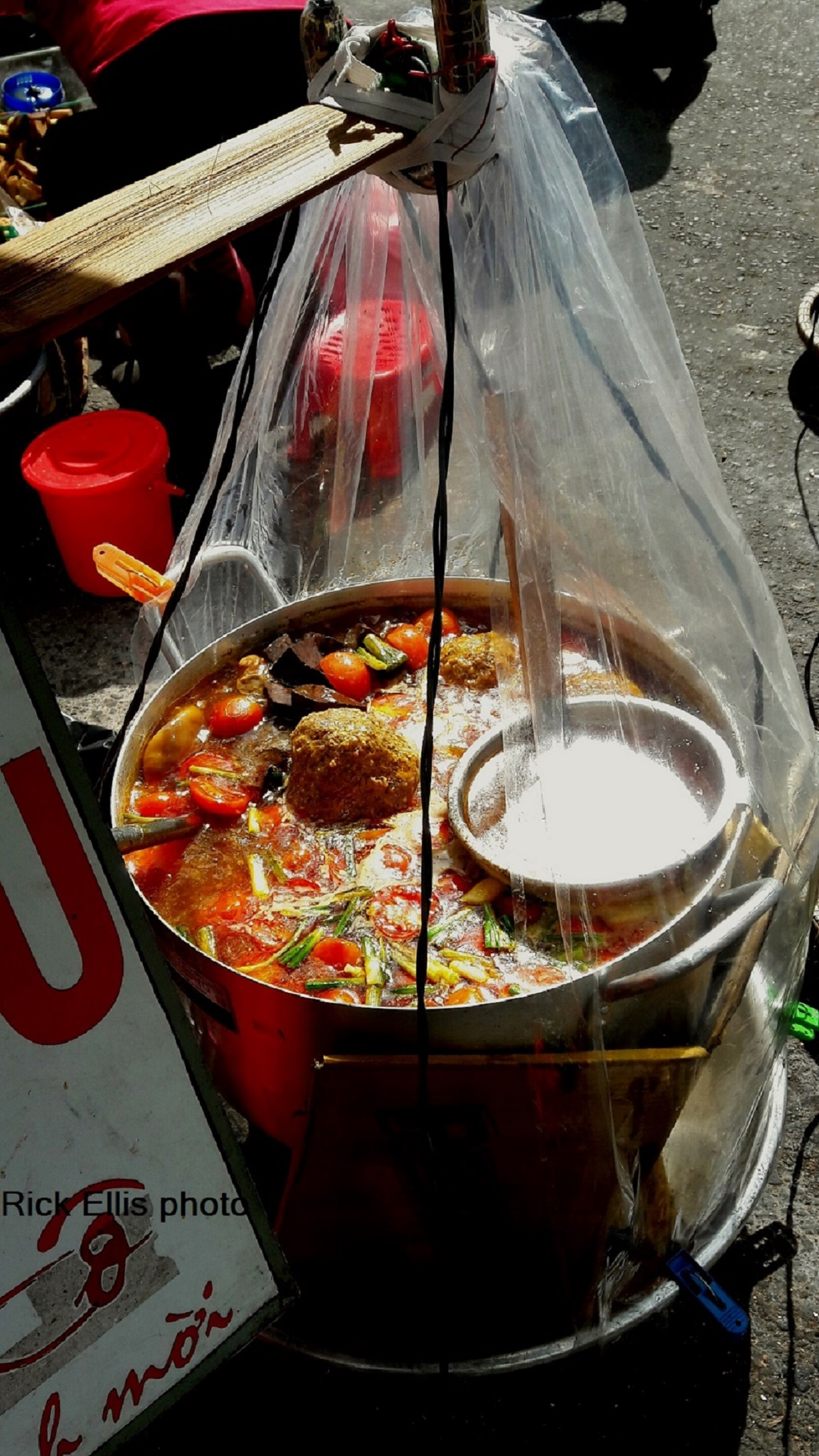 A hawker's pot of bún riêu cua (crab and tomato noodle soup) in Da Lat City, Lam Dong Province, Vietnam. Photo: Rick Ellis