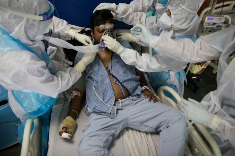 New lockdowns ordered as India virus cases near one million