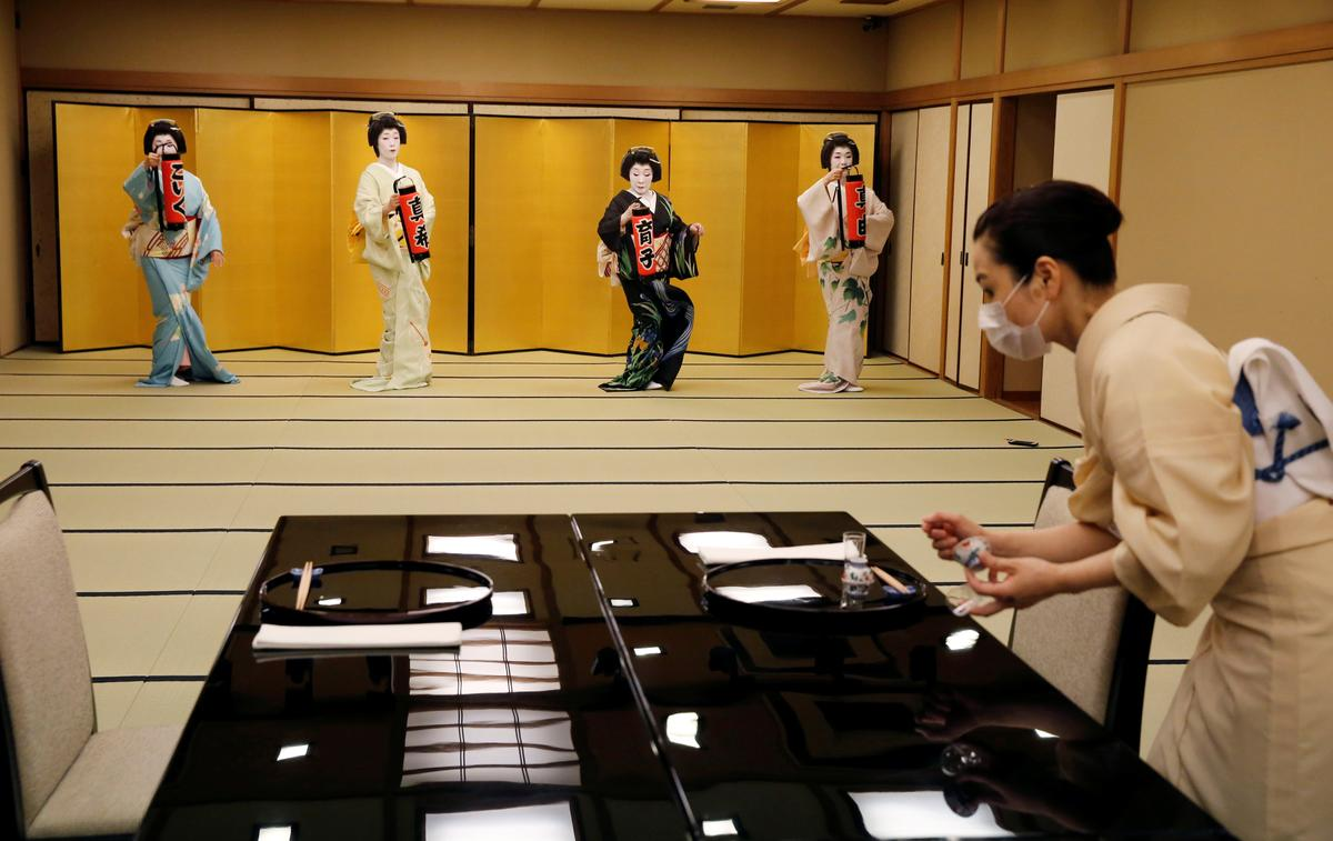 Koiku, Maki, Ikuko and Mayu, who are geisha, perform a dance routine for Reuters, before they work at a party being hosted by customers at Asada, a luxury Japanese restaurant, during the coronavirus disease (COVID-19) outbreak in Tokyo, Japan, June 23, 2020. Photo: Reuters