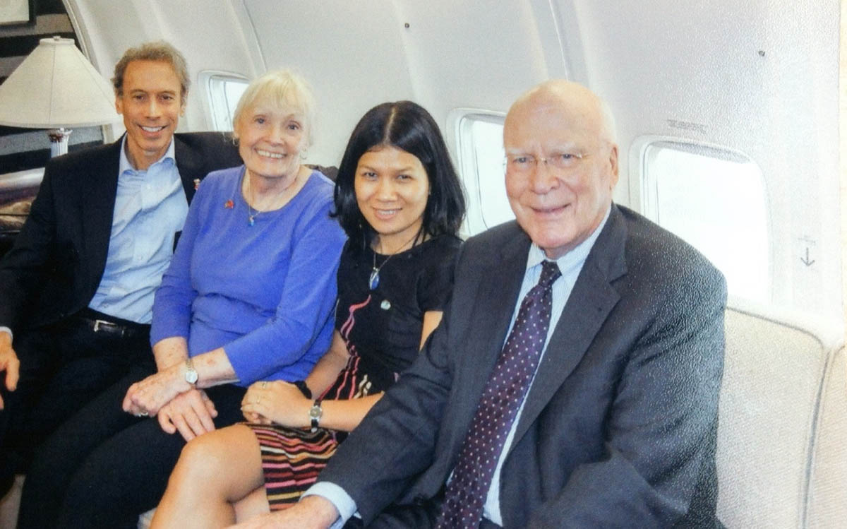 Nguyen Thu Thao (second right) with U.S. Senator Patrick Leahy (right) and his wife Marcelle Leahy (second left) on a flight to Vietnam in 2014 in a supplied photo.