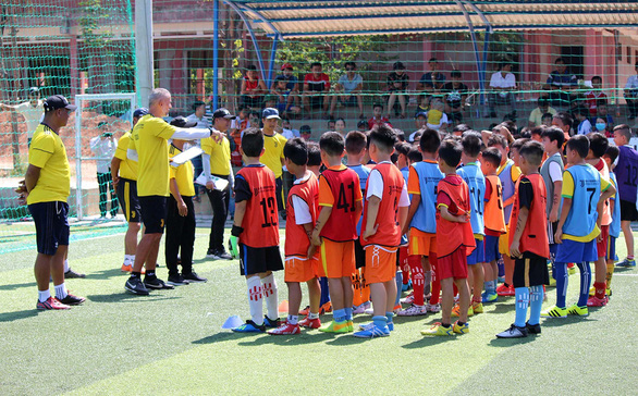 Children attend a recruitment event for the Juventus Vietnam Football Academy in June 2020 in a supplied photo.