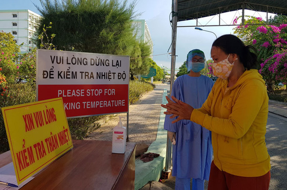 A woman washes her hands with hand sanitizer before entering the Phu Yen General Hospital in Phu Yen Province, Vietnam. Photo: Phuong Tra / Tuoi Tre