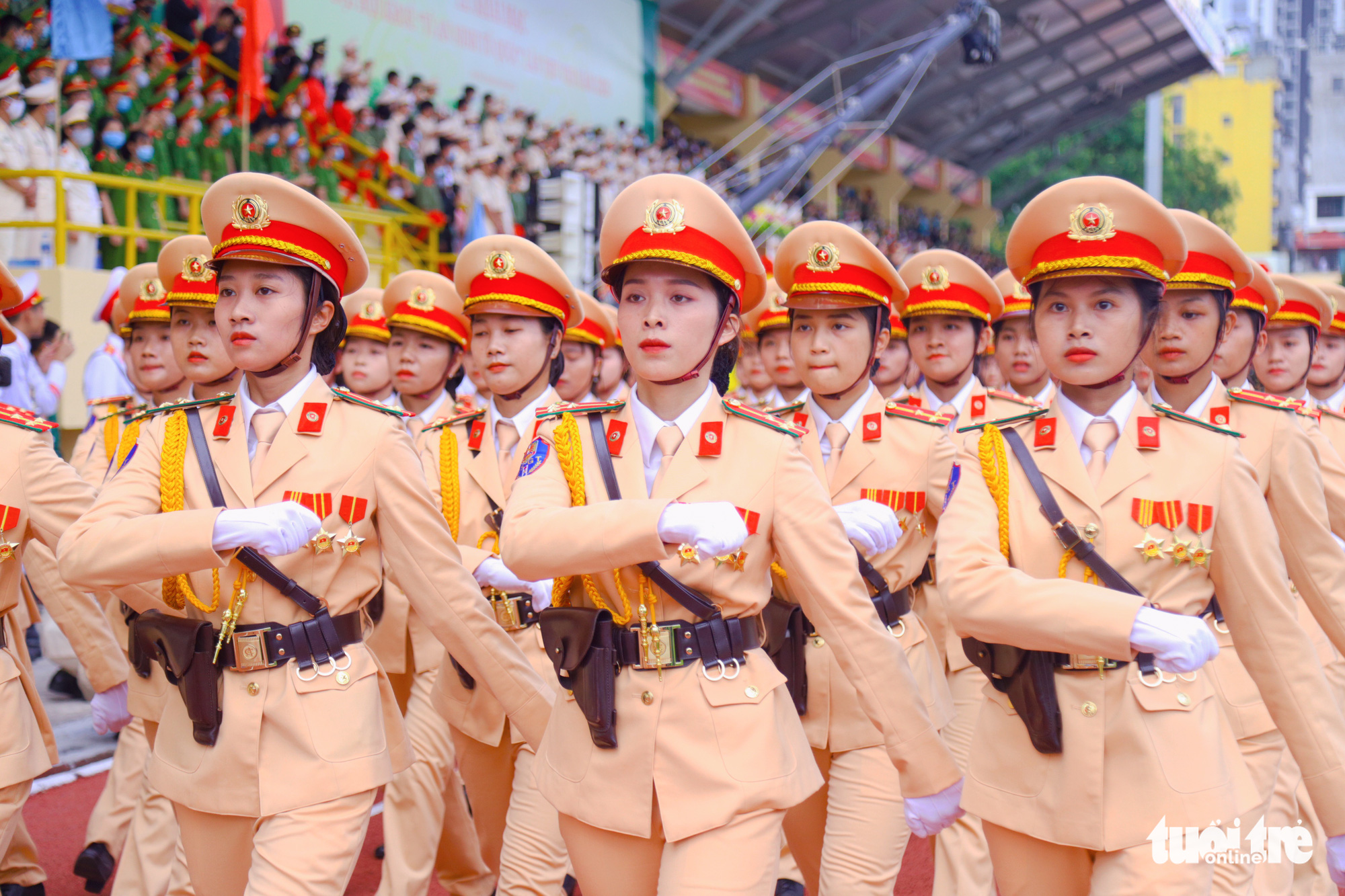 Female traffic police officers march during the opening ceremony of the 'Stay Fit for National Security' Campaign in Hanoi, August 1, 2020. Photo: Danh Trong / Tuoi Tre