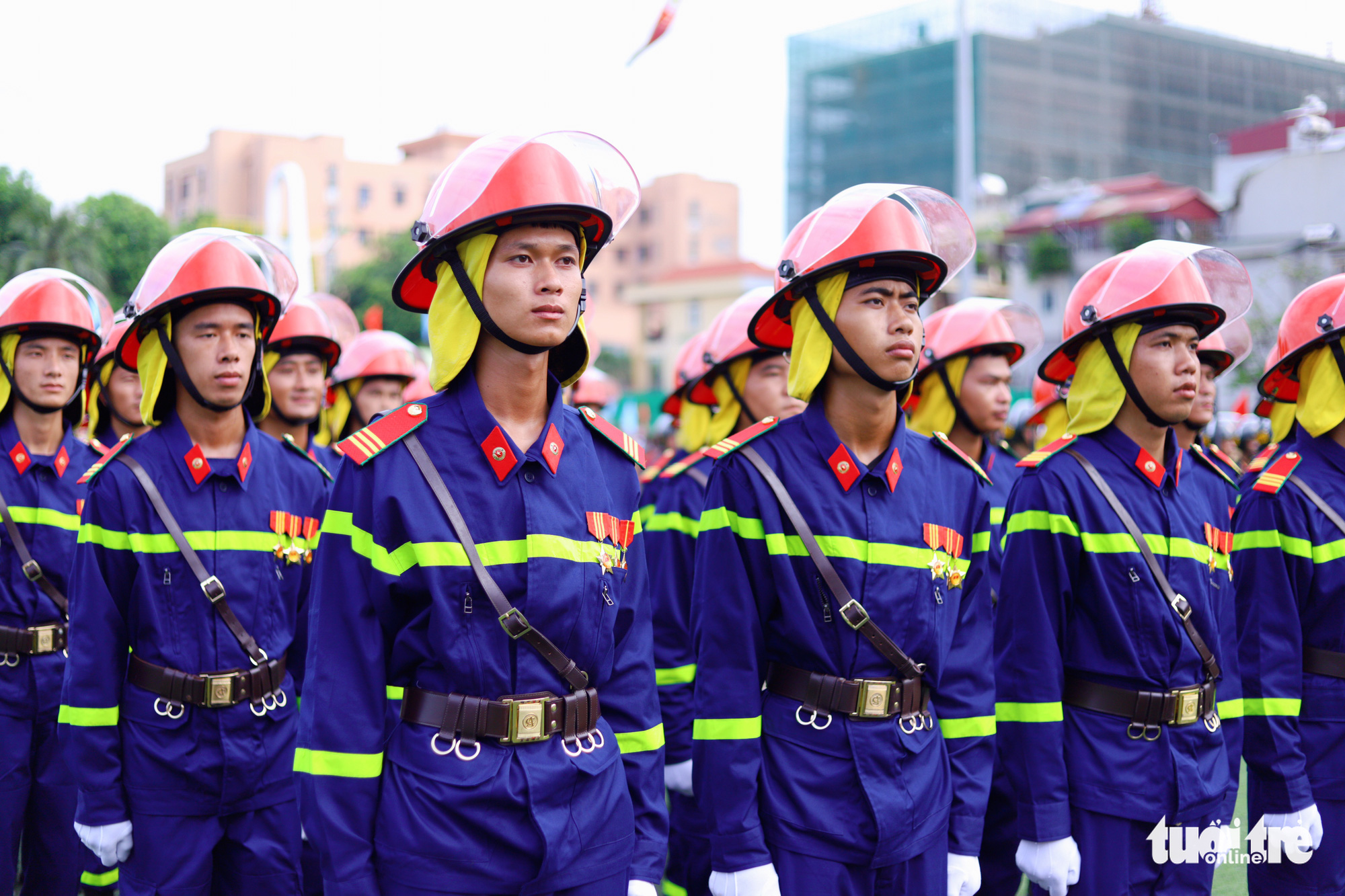 Firefighting police officers are pictured at the opening ceremony of the 'Stay Fit for National Security' Campaign in Hanoi, August 1, 2020. Photo: Danh Trong / Tuoi Tre