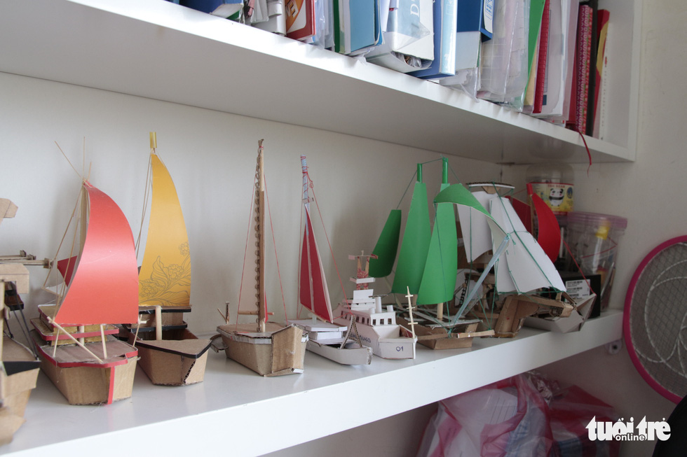 A collection of DIY ship models is displayed on a shelf in Sang's house. Photo: Cong Trieu / Tuoi Tre