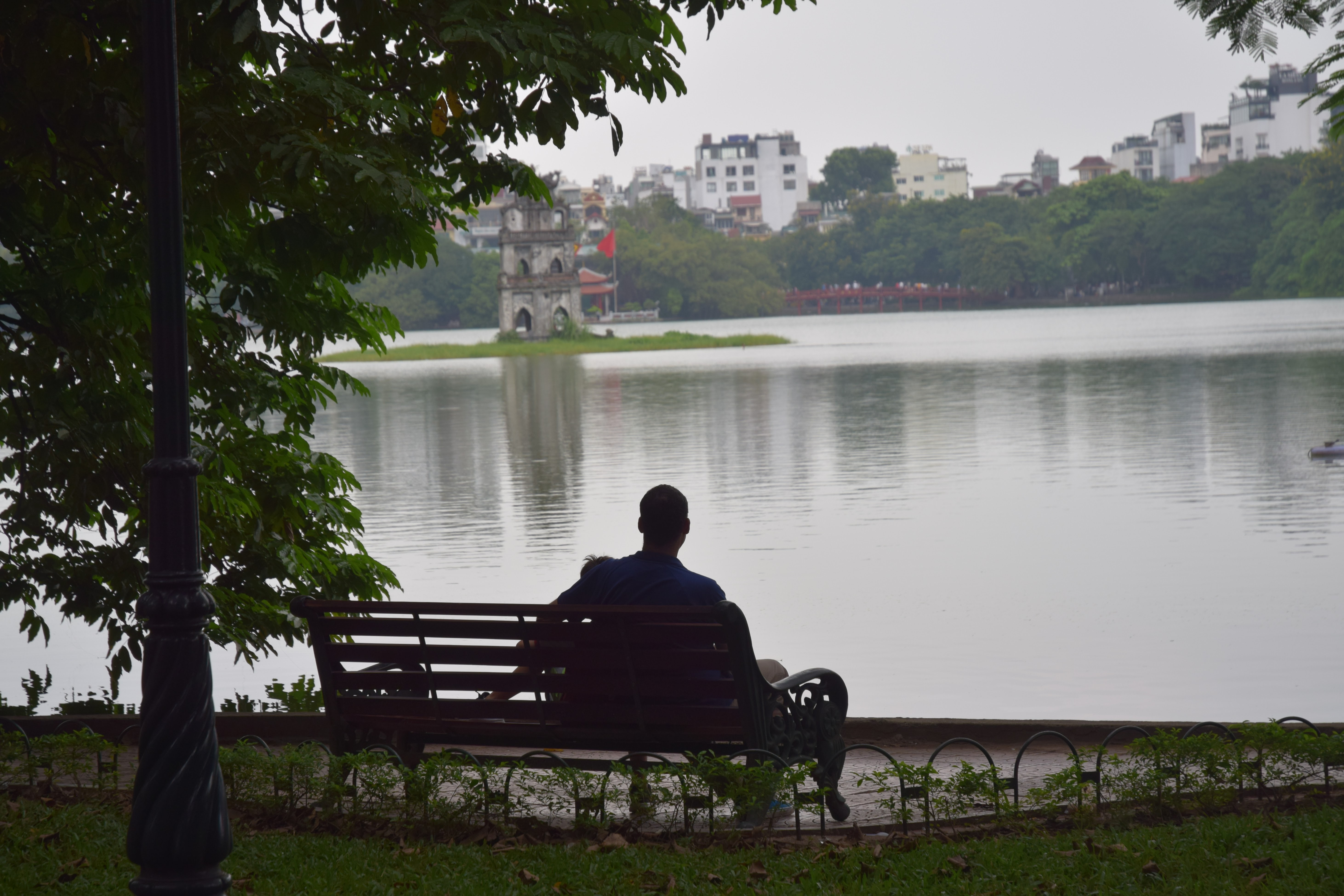 Kyle Nunas and his son at Hoan Kiem Lake in 2018 in a photo provided to Tuoi Tre News. 'I took a photo of a stranger from nearly this exact spot 20 years ago, Nunas wrote a caption for this photo.