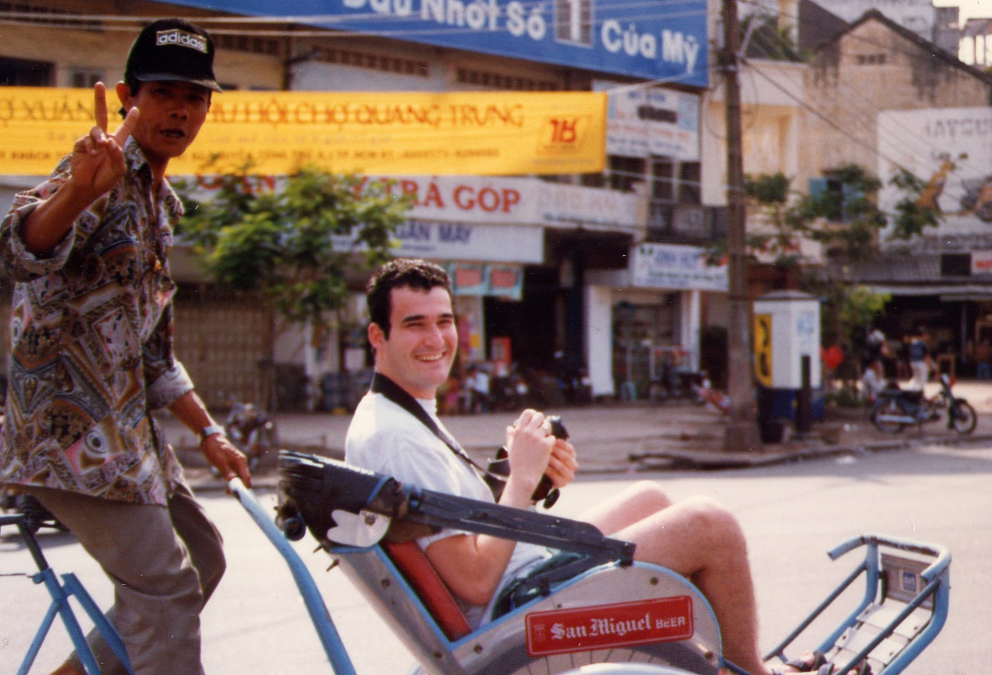 Kyle Nunas poses while sitting on a cycle during his first trip to Vietnam as a tourist in 1997. Photo: Supplied