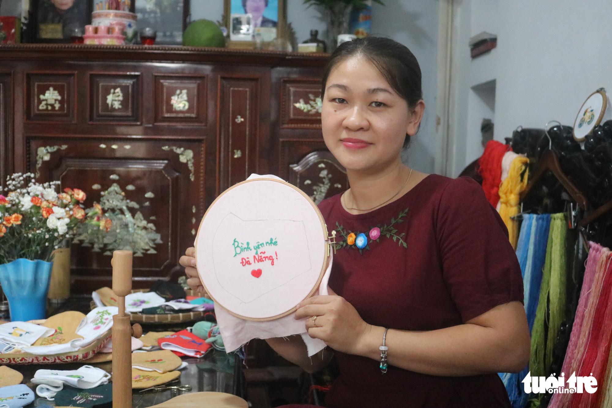 Amateur embroidery artists turn masks into fashion items amid coronavirus pandemic in Vietnam