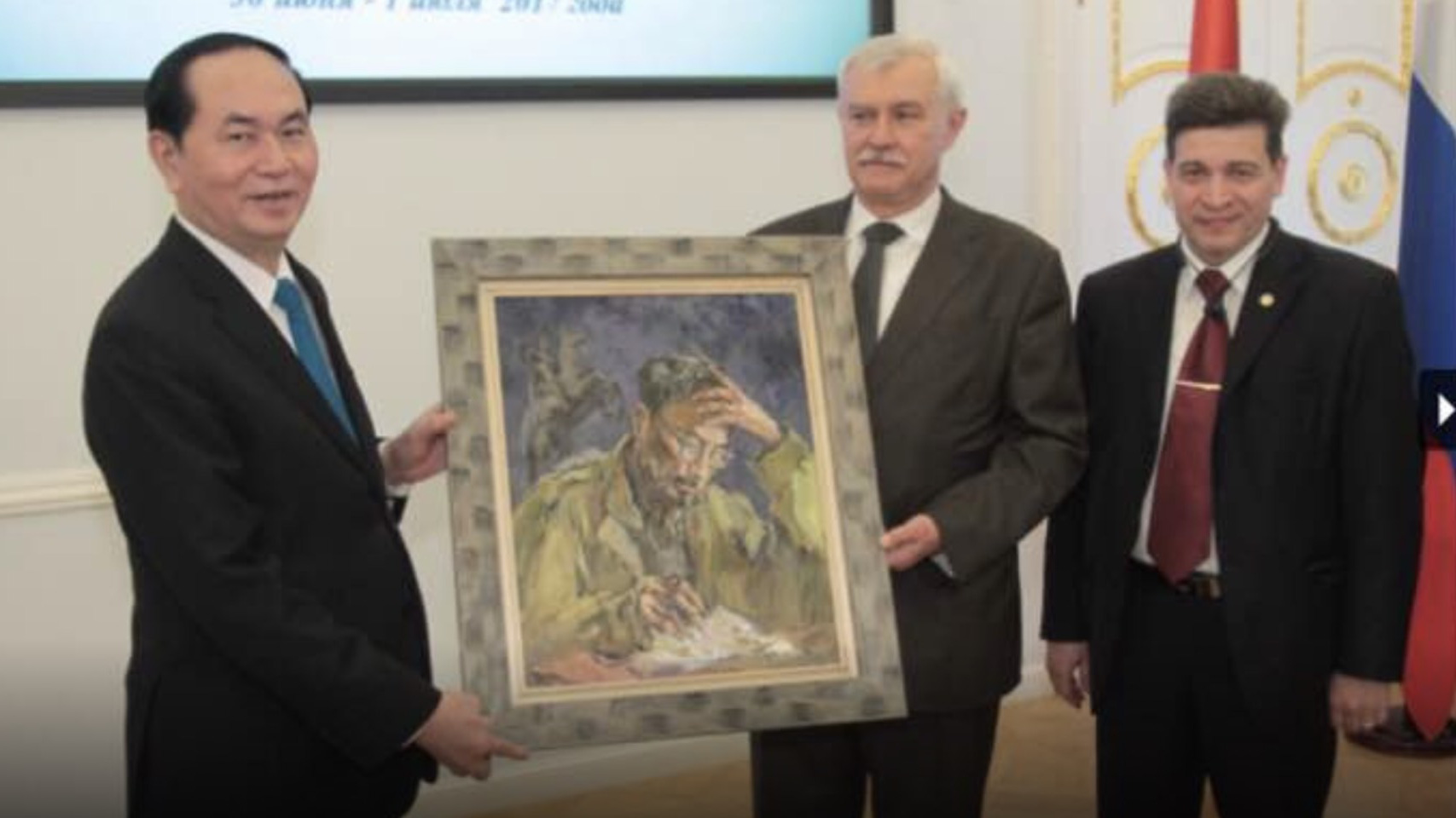 A portrait of late Vietnamese President Ho Chi Minh painted by Tuman Zhumabaev is presented as a gift to Vietnam's then-incumbent State President Tran Dai Quang (left) by Russian government representatives in this photo captured in 2017 and provided by Lilac gallery.