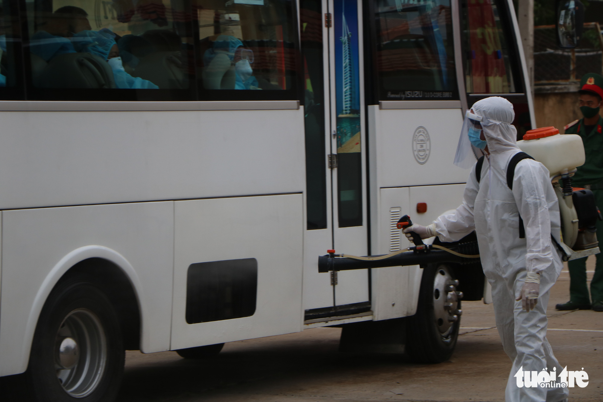 A vehicle carrying Vietnamese citizens brought home from Malaysia is disinfected before entering a novel coronavirus disease (COVID-19) quarantine facility in Ninh Thuan Province, Vietnam. Photo: Minh Tran / Tuoi Tre