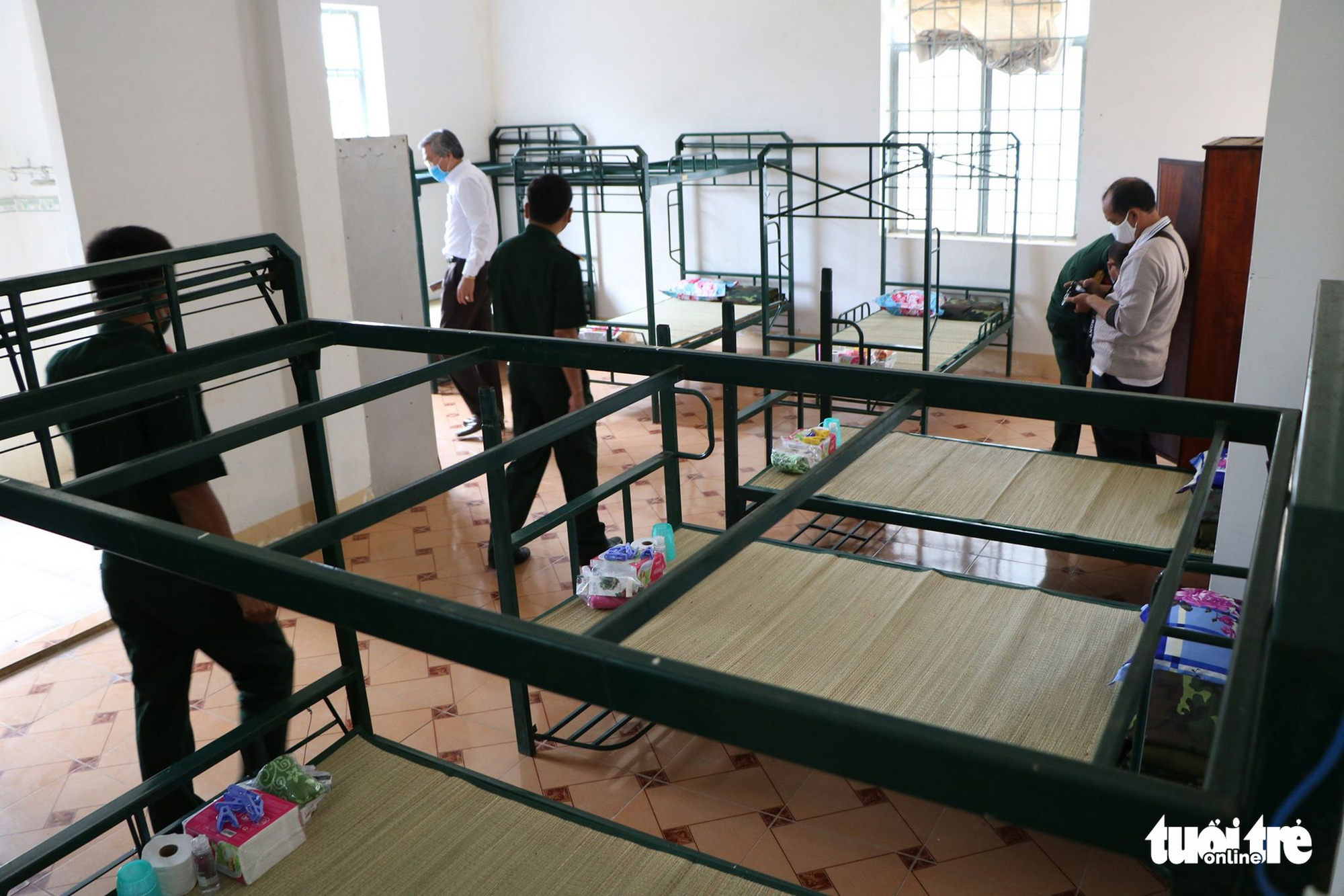 Officers inspect a room inside a facility for novel coronavirus disease (COVID-19) quarantine in Ninh Thuan Province, Vietnam. Photo: Minh Tran / Tuoi Tre