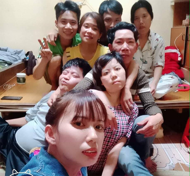 The physically impaired tenants at rented rooms in Ngo Quyen District, Hai Phong City, Vietnam pose for a supplied group selfie.