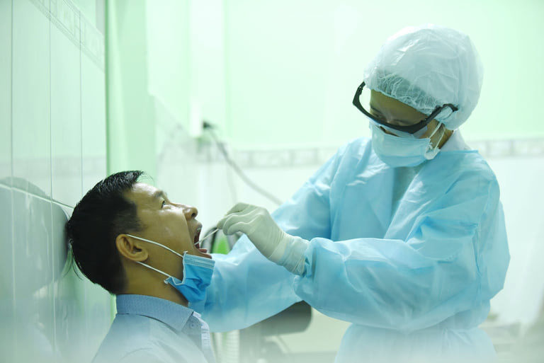 Saigon to expand COVID-19 screening to returnees from four virus-hit localities