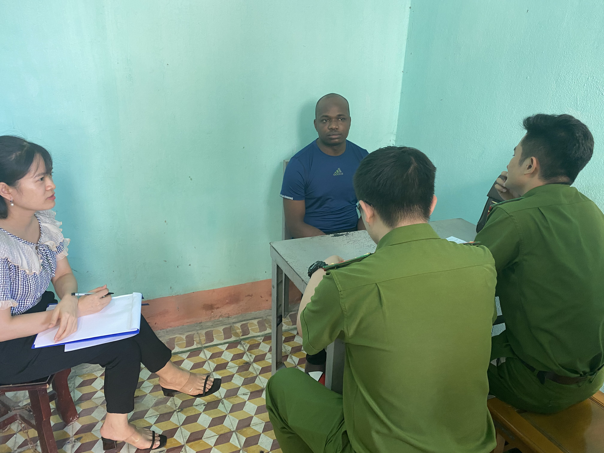 Nigerian Ajearo Chuckwugekwu Godwin, 34, is interrogated by officers at a police station in Thanh Hoa Province, Vietnam in this supplied photo.