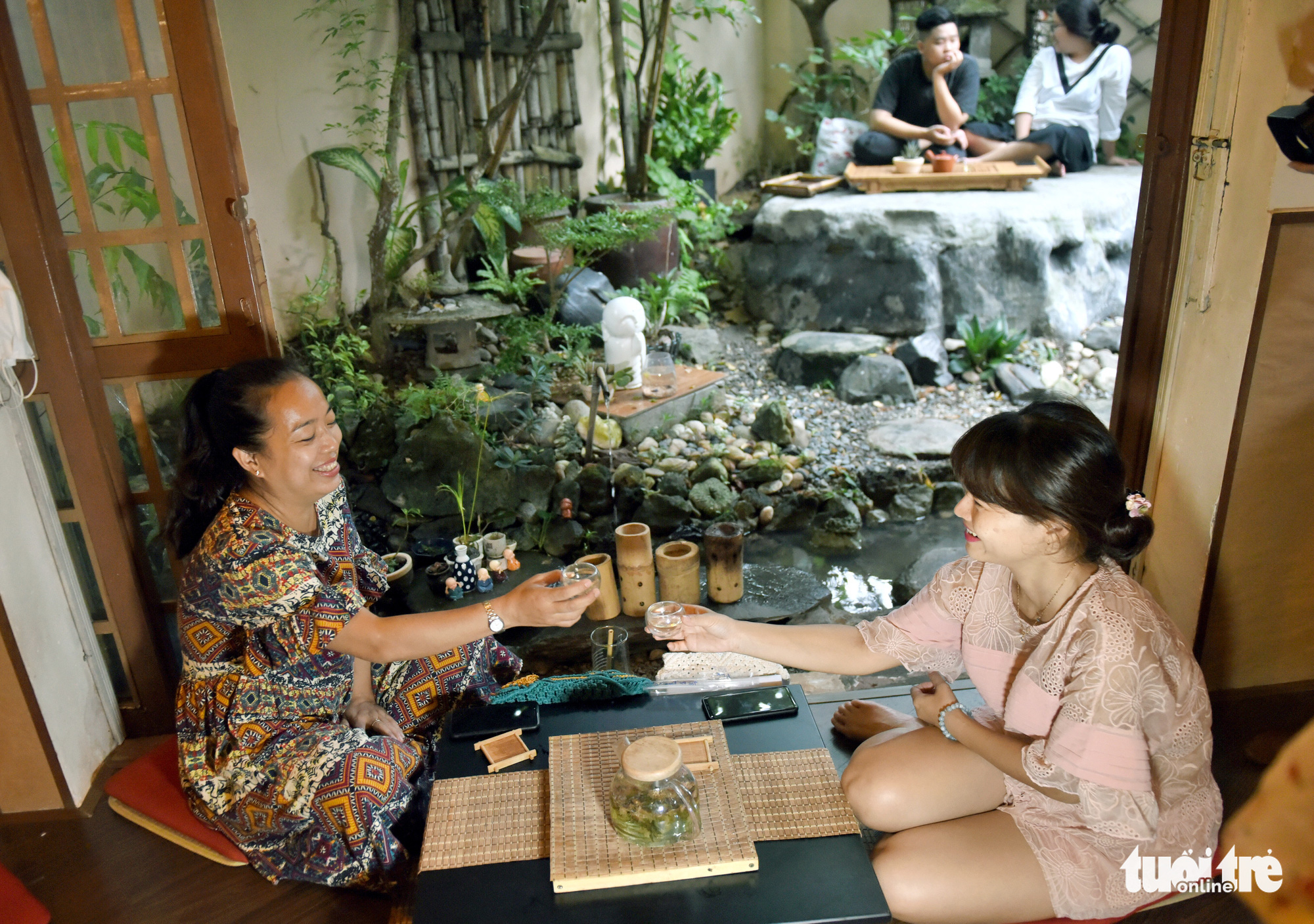 Two friends enjoy tea at the Zentea teahouse in Ho Chi Minh City, Vietnam. Photo: Tuoi Tre
