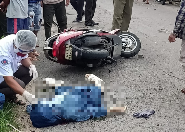 N.L.M.S. lies next to her motorbike following an explosion in Quang Nam Province, Vietnam, August 28, 2020 in a supplied photo.