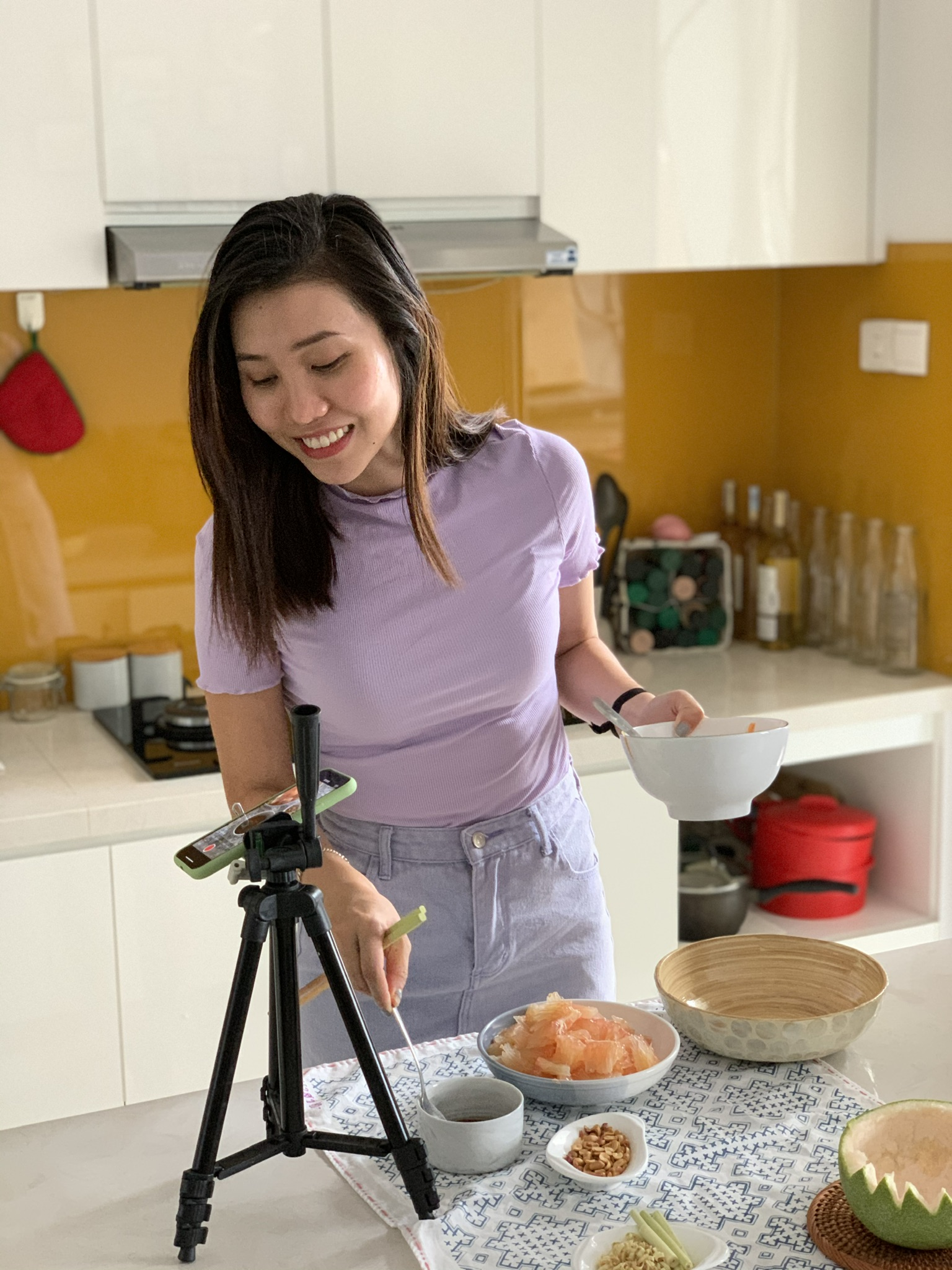 Nguyen Ho Tra My filming a TikTok cooking video.