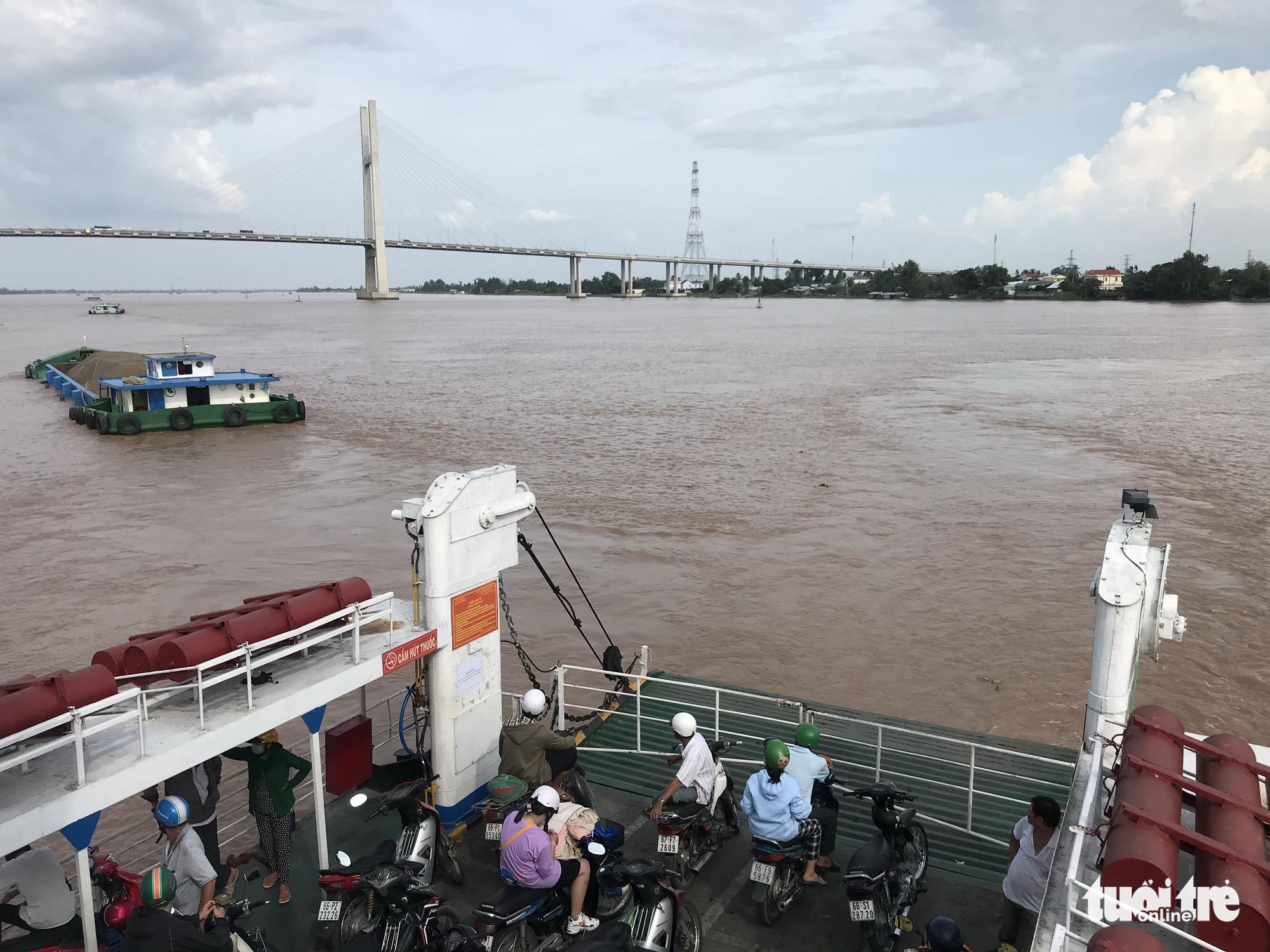 Defunct century-old ferry in Vietnam's Mekong Delta now water under the bridge