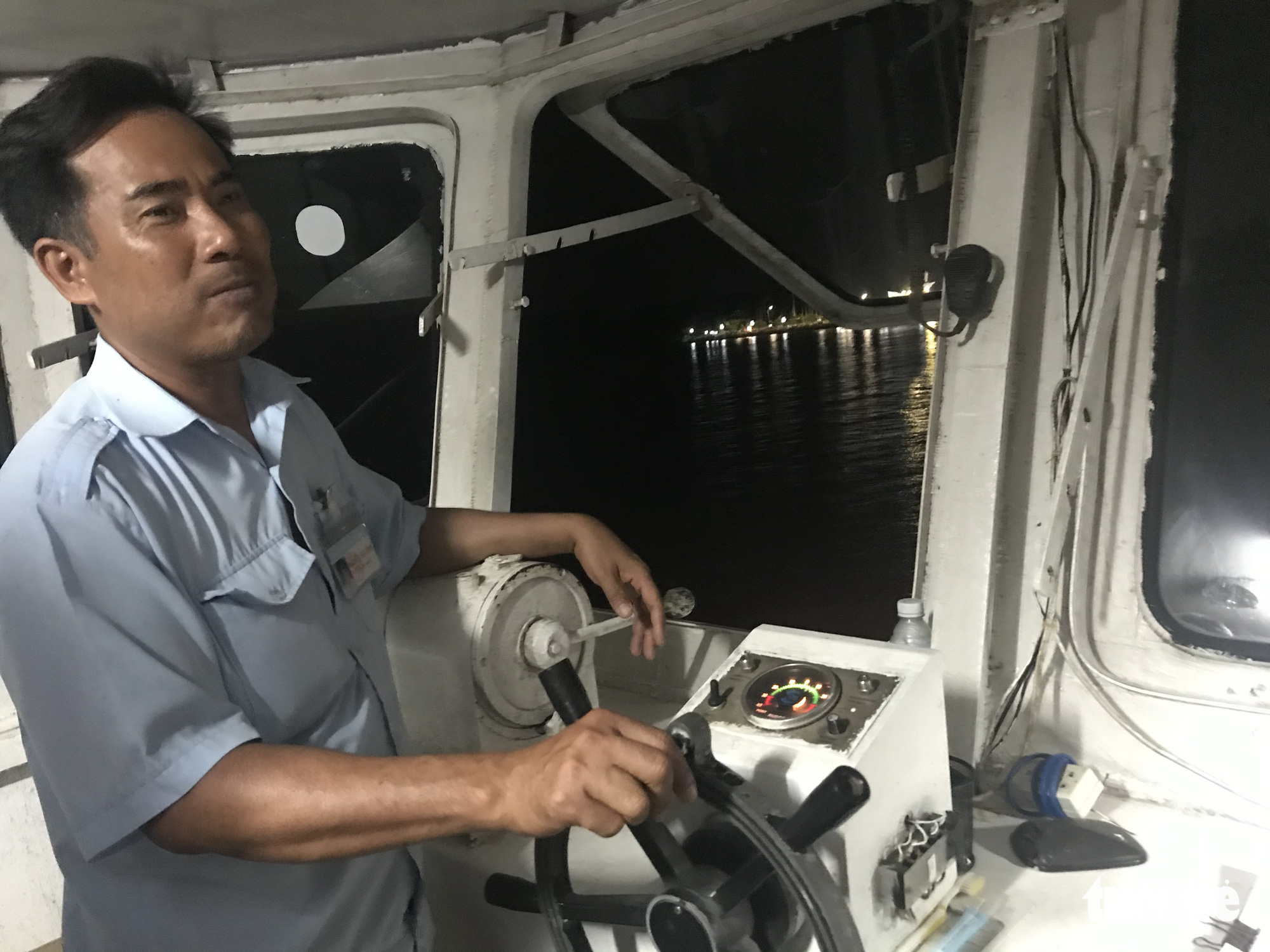 Nguyen Van Tinh, a seasoned captain, is pictured during his last ride on the Cao Lanh Ferry, which was in operation for nearly 100 years in Cao Lanh City, the heart of Dong Thap Province, southern Vietnam. Photo: Thanh Nhon / Tuoi Tre