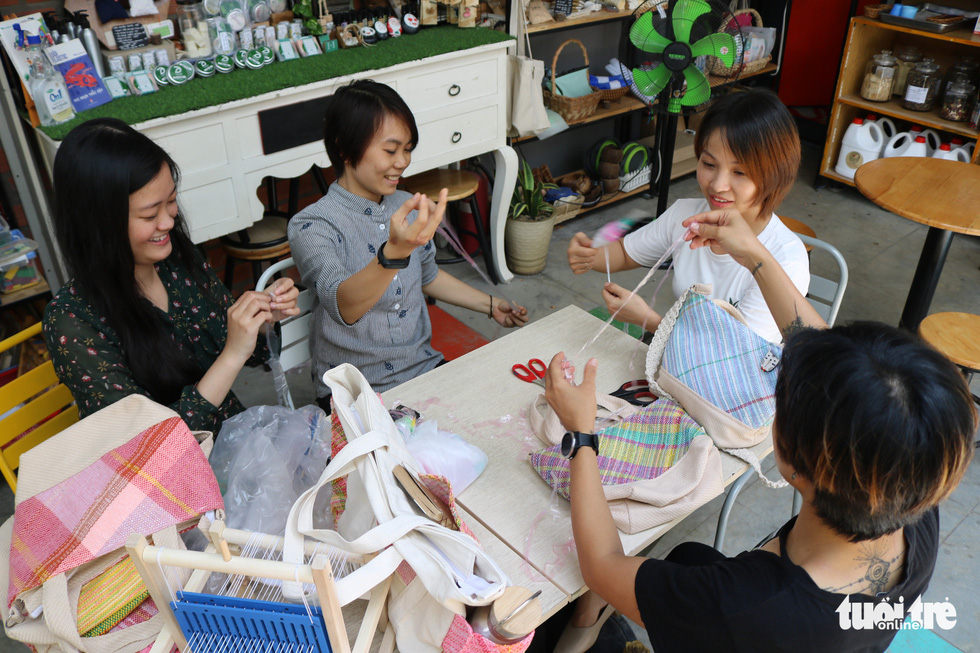 Vietnamese woman makes fashion bags from recycled plastic, waste cloth