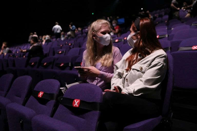Theatregoers sit keeping a social distance as a precaution against the transmission of the novel coronavirus ahead of the start of Sleepless the Musical at the Troubadour Wembley Park Theatre in London on September 10, 2020. Photo: AFP