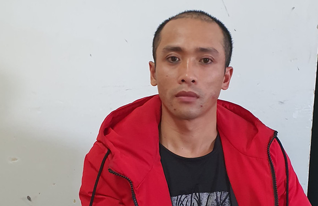 Nguyen Quoc Hung is held at the police station in Da Lat City, Vietnam in this supplied photo.
