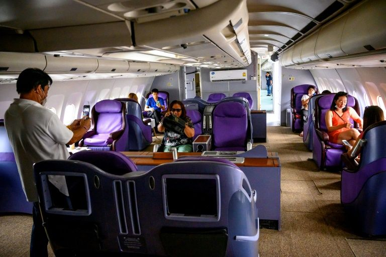 In Thailand 'plane cafes' are offering customers the chance to pretend they are in the sky -- and the idea seems to have taken off. Photo: AFP