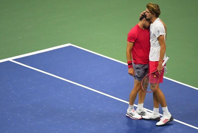 Dominic Thiem of Austria embraces Alexander Zverev of Germany after defeating Zverev in the men's singles final match on day 14 of the 2020 U.S. Open tennis tournament at USTA Billie Jean King National Tennis Center, Flushing Meadows, New York, USA, Sep 13, 2020. Photo: USA TODAY Sports via Reuters